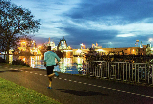 Wall Art - Photograph - Man Jogging Along Waterfront At Sunset by Michael Hanson