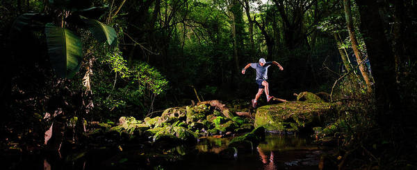 Jumping Photograph - Man Jumping Across A River, Kloof by Panoramic Images