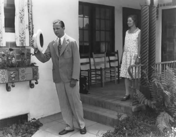 Wall Art - Photograph - Man Leaving His House by Underwood Archives