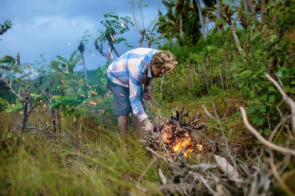 Wall Art - Photograph - Man Near Campfire In Tropical Scenery by Konstantin Trubavin