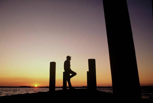 Man On Dock At Sunset Art Print