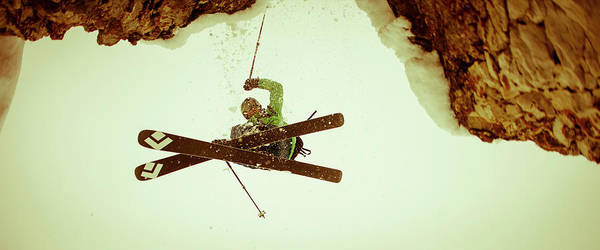 Ski Jumping Photograph - Man On Skis Jumps Cliff From Above by Gabe Rogel