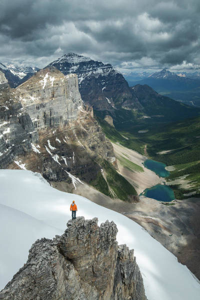 Consolation Wall Art - Photograph - Man Overlooking Consolation Lakes by Paul Zizka