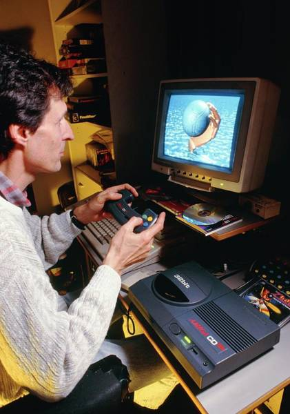 Roms Photograph - Man Playing Games On Home Computer & Cd-rom Drive by Jerry Mason/science Photo Library