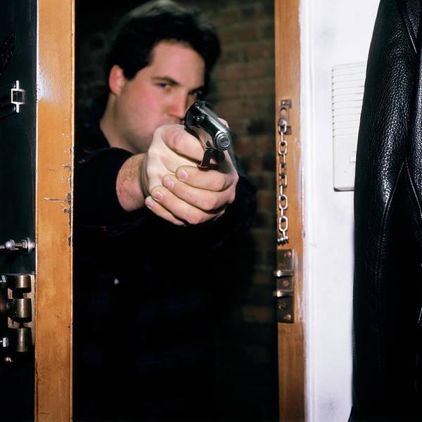Space Gun Photograph - Man Pointing Gun Through Doorway by Vintage Images