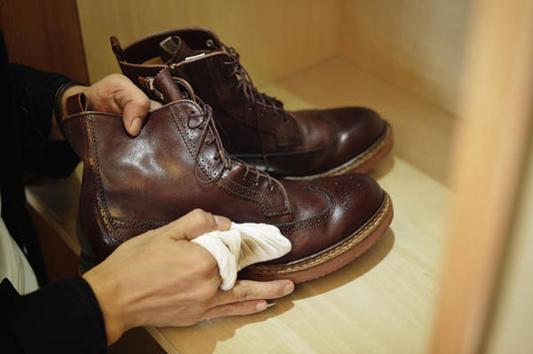 Man Polishing Leather Shoes Art Print by Yagi Studio