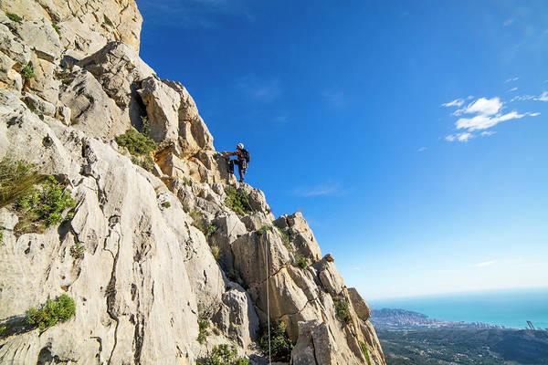 Benidorm Wall Art - Photograph - Man Rock Climbing On Peak Of Puig by Bennett Barthelemy