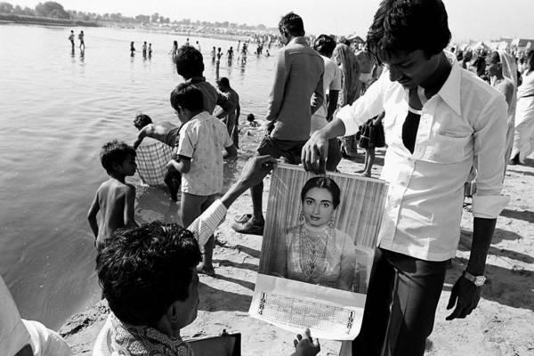 Bollywood Wall Art - Photograph - Man Showing Bollywood Calendar by Jagdish Agarwal