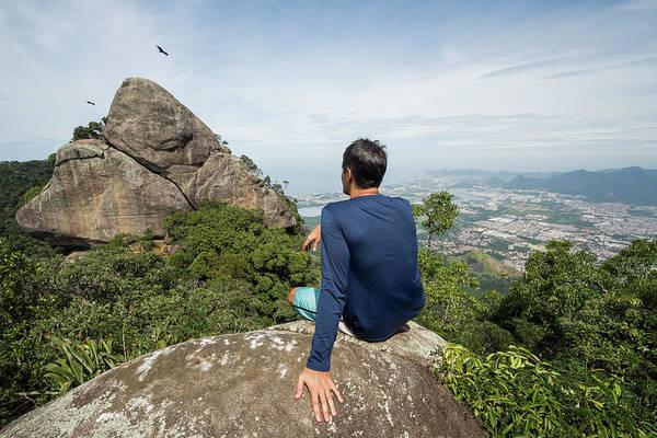 Wall Art - Photograph - Man Sitting On Rock In Natural Setting by Vitor Marigo