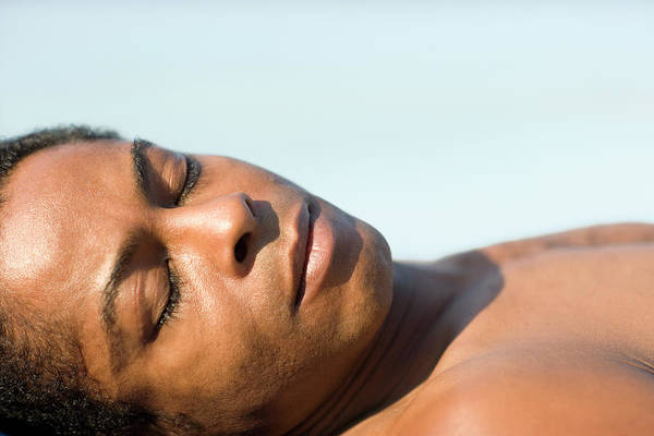 Sunbather Wall Art - Photograph - Man Sleeping In The Sun by Ian Hooton/science Photo Library