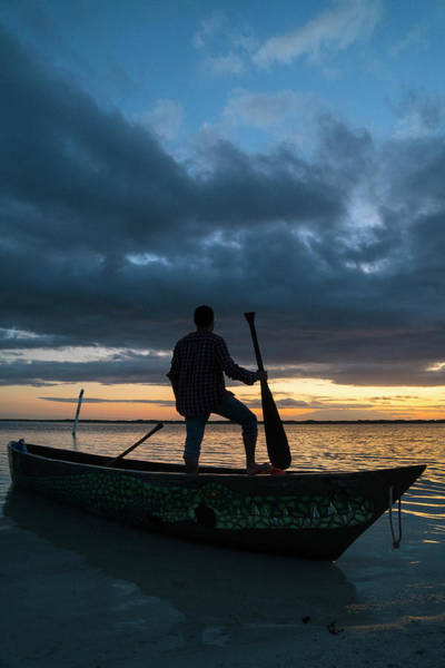 Wall Art - Photograph - Man Standing In Canoe On Seashore by Marcos Ferro