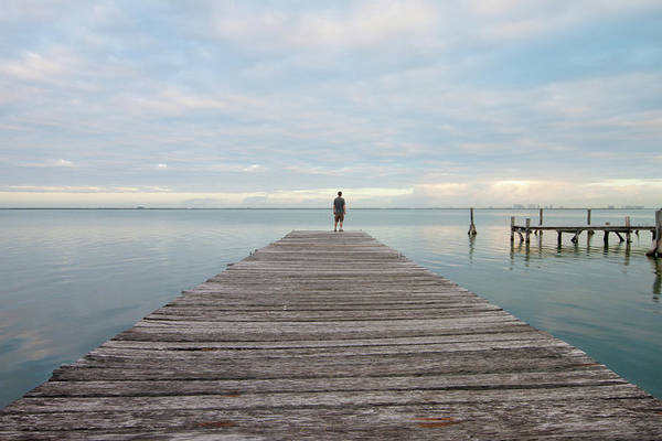 Quintana Roo Photograph - Man Standing On A Pier by Lightvision