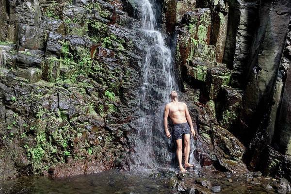 La Gomera Wall Art - Photograph - Man Standing Under Waterfall, La by Sergio Villalba