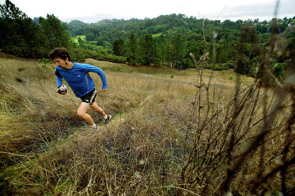 Difficult Photograph - Man Trail Running On A Foggy Day by Corey Rich