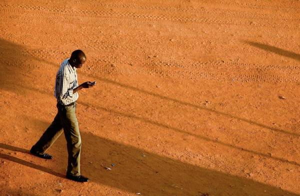 Uganda Wall Art - Photograph - Man Using A Mobile Phone by Mauro Fermariello/science Photo Library