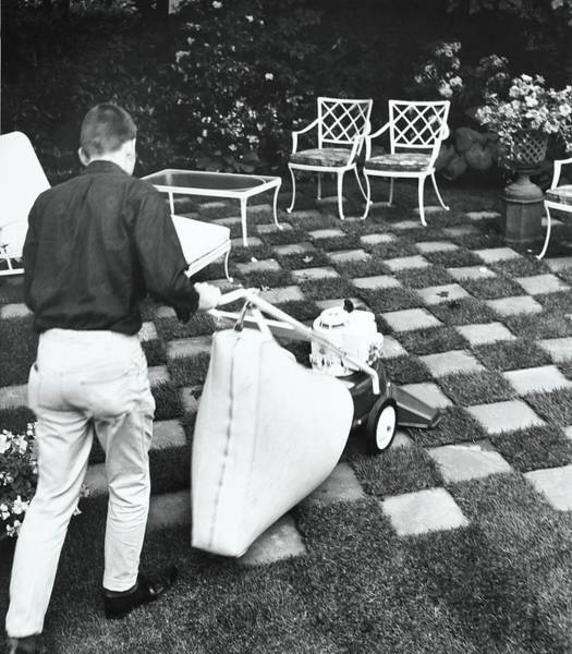 Patio Photograph - Man Using Lawn Vacuum by Pedro E. Guerrero