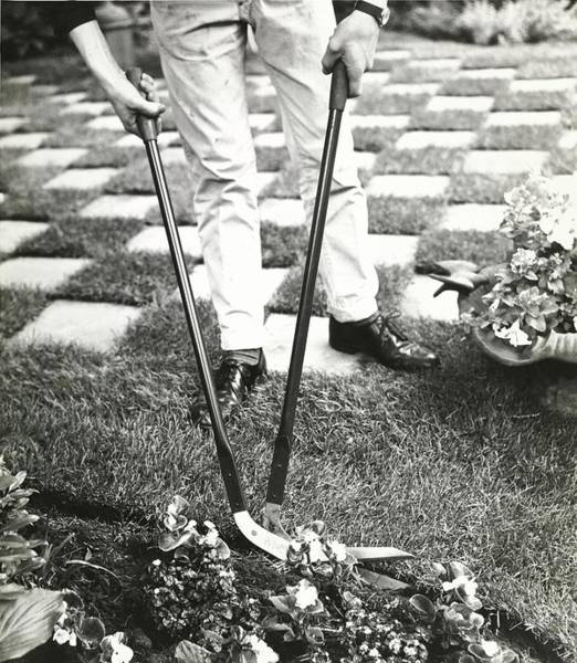 Landscape Architecture Photograph - Man Using Turf Trimmers by Pedro E. Guerrero