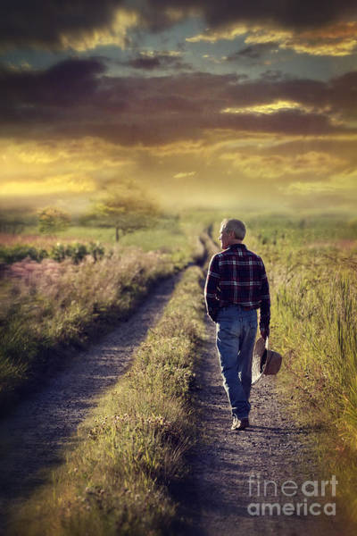 Photograph - Man Walking Down A Country Road At Sunset by Sandra Cunningham