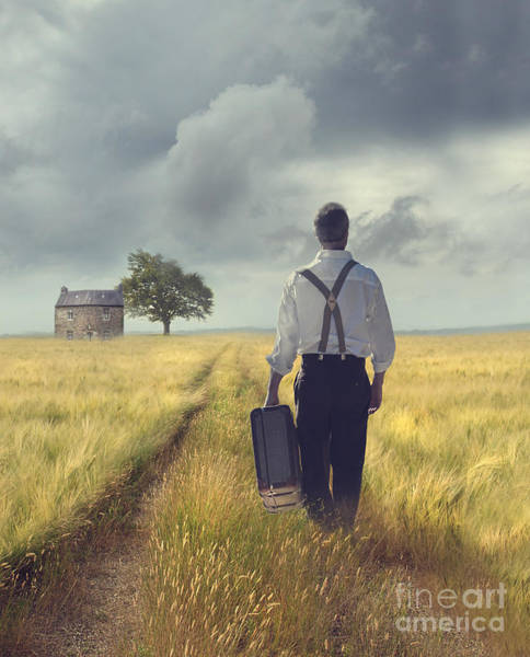 Photograph - Man Walking Down Road With Suitscase by Sandra Cunningham