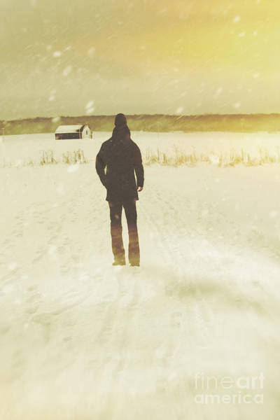 Photograph - Man Walking In Snow Storm Towards A Barn by Sandra Cunningham