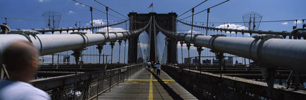 One Way Road Photograph - Man Walking On A Bridge, Brooklyn by Panoramic Images