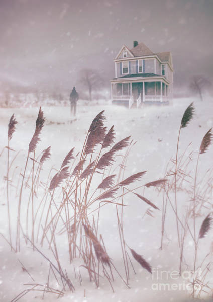 Photograph - Man Walking Towards Old Farm House In Snow Storm by Sandra Cunningham