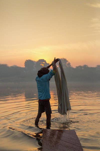 Candid Photograph - Man Washing Sheet In Yamuna River, Agra by Adrian Pope