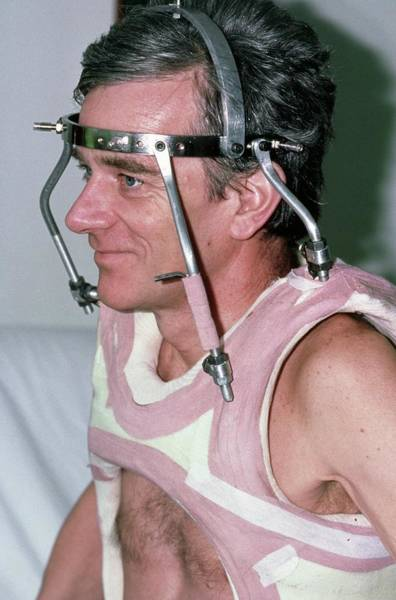 Neck Brace Photograph - Man Wearing A Neck Brace After A Spinal Fracture by Dr P. Marazzi/science Photo Library