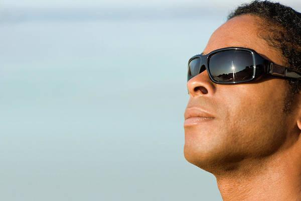 Sunbather Wall Art - Photograph - Man Wearing Sunglasses by Ian Hooton/science Photo Library