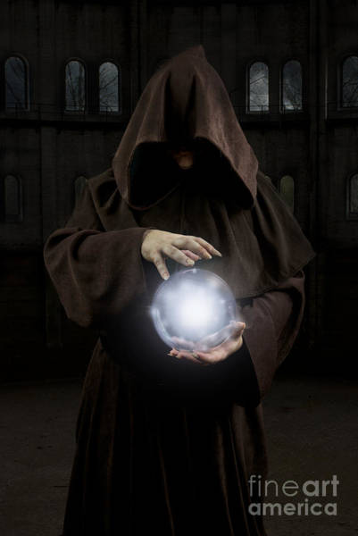 Photograph - Man Wearing The Cloak With Hood Holding Glowing Crystal Ball by Jaroslaw Blaminsky