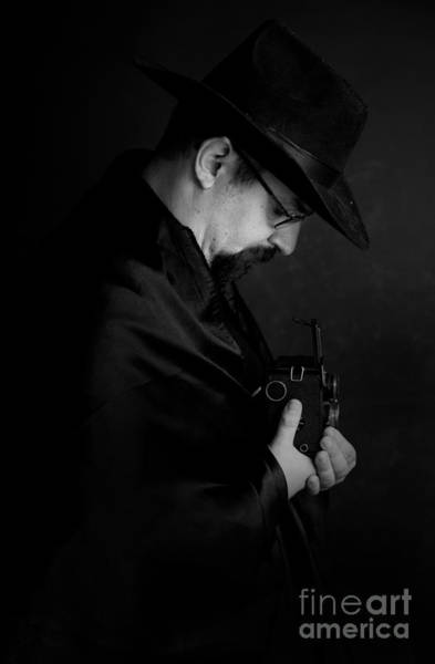 Photograph - Man With Glasses And Black Hat Holding An Old Camera by Jaroslaw Blaminsky