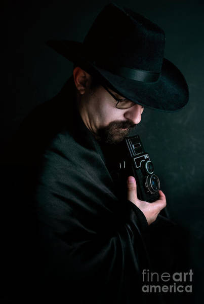 Photograph - Man With Goatee And Black Hat Holding An Old Style Camera by Jaroslaw Blaminsky