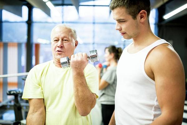 Senior Photograph - Man Working Out With Dumbbells by Science Photo Library