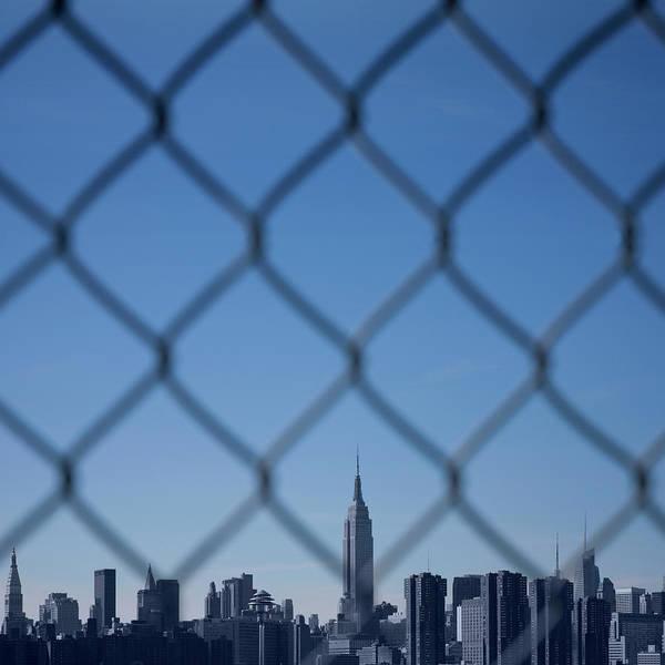 Fence Photograph - Manhattan Skyline Through The Fence by Maciej Toporowicz, Nyc