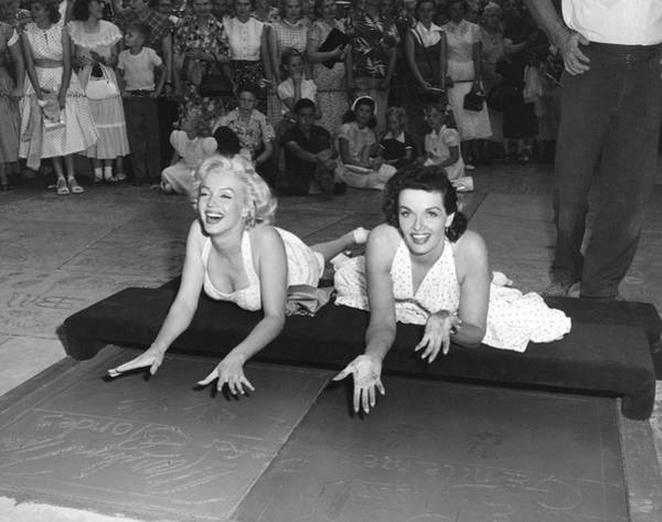Cement Wall Art - Photograph - Marilyn Monroe And Jane Russell by Underwood Archives