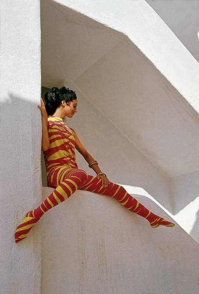 Facade Photograph - Marisa Berenson In An Orange And Yellow Striped by Henry Clarke