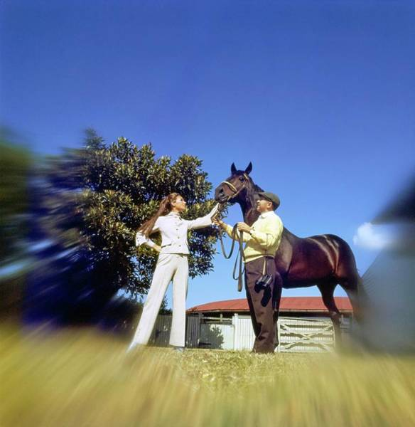 Wall Art - Photograph - Marisa Berenson Standing By A Horse by Arnaud de Rosnay
