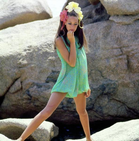 Wall Art - Photograph - Marisa Berenson Wearing A Green Romper by Henry Clarke