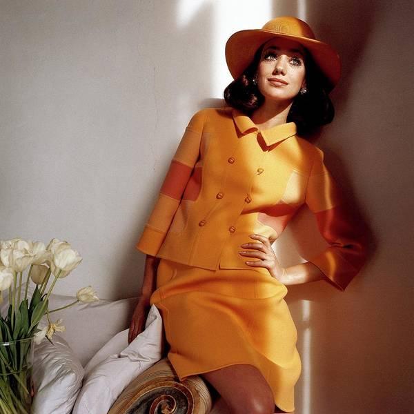 Orange Flower Photograph - Marisa Berenson Wearing An Orange Skirt Suit by Henry Clarke