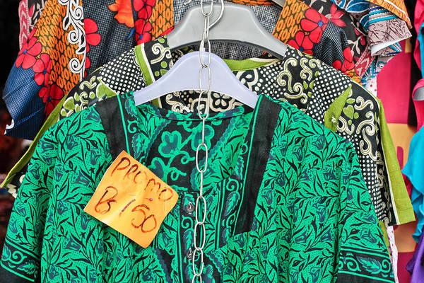 Dress Shop Photograph - Market Clothes by Tom Gowanlock