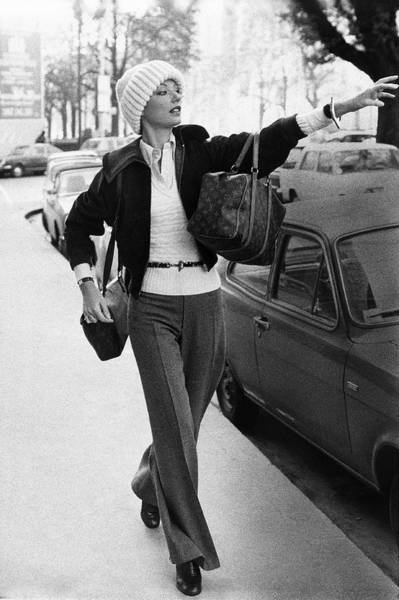 Knit Hat Photograph - Mary Russell Hailing A Cab by Henry Clarke