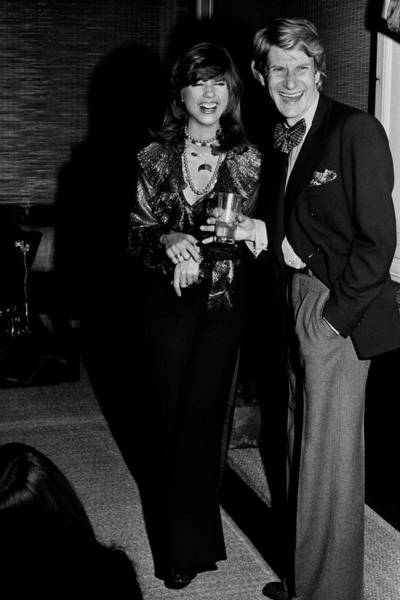 Two People Photograph - Mary Russell Laughing With Yves St. Laurent by Henry Clarke
