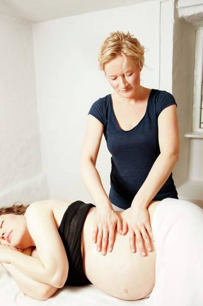 Therapist Photograph - Massage In Pregnancy by Thomas Fredberg