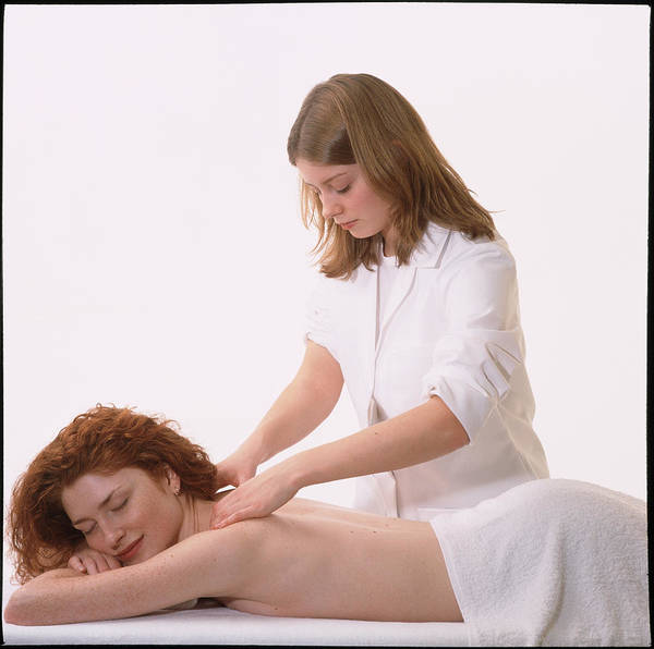 Wall Art - Photograph - Masseuse Massages The Neck & Shoulders Of A Woman by Damien Lovegrove/science Photo Library