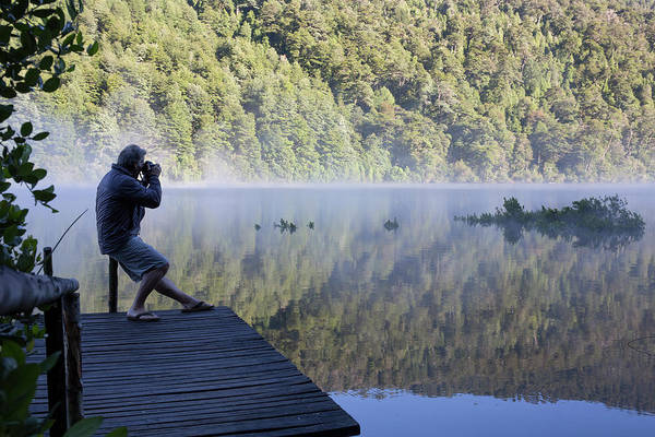 Wall Art - Photograph - Mature Man Takes Photo On Dock In Lake by Philip & Karen Smith / TFA