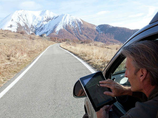 Road Map Photograph - Mature Man Uses Digital Tablet From Car by Philip & Karen Smith / TFA