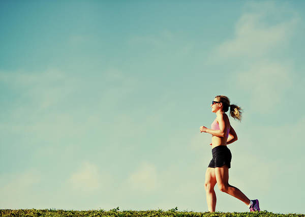 Content Photograph - Mature Woman Jogging Outdoors by Anouchka