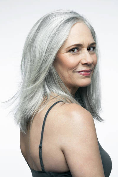 Mature Woman With Grey Hair In A 3/4 Position. Art Print by Andreas Kuehn
