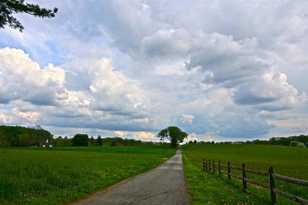 Photograph - May Storm Clouds And A Patch Of Blue Over The Farm by Byron Varvarigos