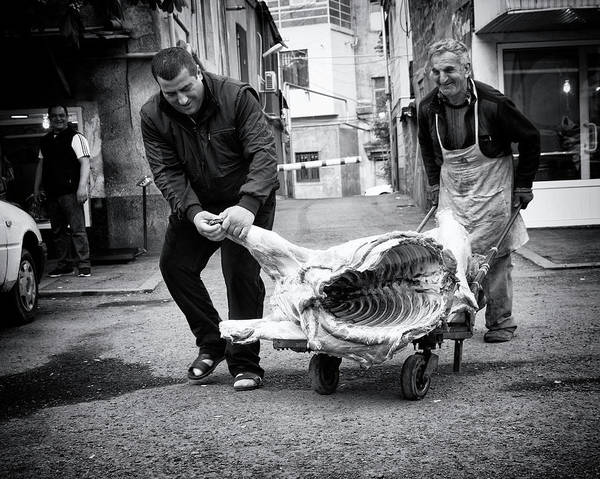 Street Photograph - Meat Is Coming by Marcel Rebro